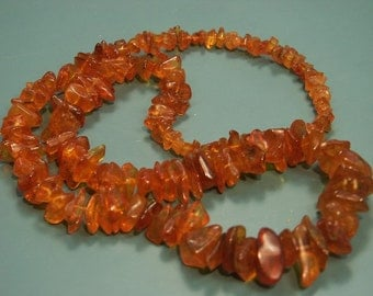 Wonderful 1960s graduated polished real natural organic baltic amber chip necklace in marvelous goldbrown colors