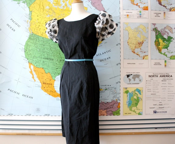Vintage wiggle dress in black with polka dot puff sleeves 1950s
