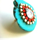 Large and Chunky Turquoise Ring with milky white and orange rhinestones.