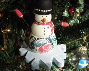 Norwegian Snowman on a Snowflake Ornament