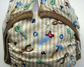 Diaper cover PUL lined Handy Man Tools print on tan- cream ground 12-24 pounds