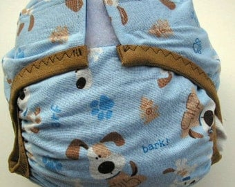 12-24 pounds Diaper cover PUL lined Puppy print on blue ground trimmed in brown elastic size Medium