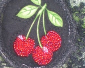 Brooch with beaded cherries and lace ribbon
