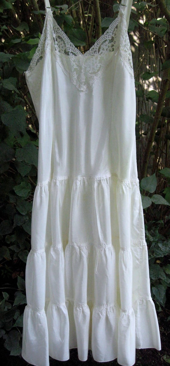 Vintage women's slip with ruffles and lace