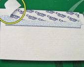 50 4 1/8 x 9 1/2 Grip-Seal Security White Envelopes