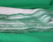 Un paper Towels Green trim reusable birds eye cotton napkin