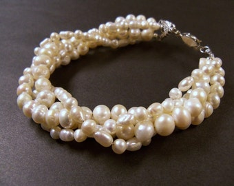Multiple strand freshwater pearl twisted bracelet with antiqued silver clasp