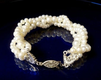 Set of 4 multistrand freshwater pearl twisted bracelets and 2 pairs of matching drop pearl earrings