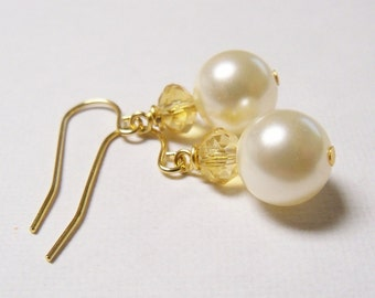 Swarovski cream and champagne crystal pearl drop earrings on gold plated surgical steel earwires