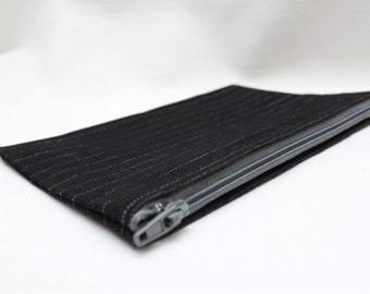 Small black pinstriped pouch