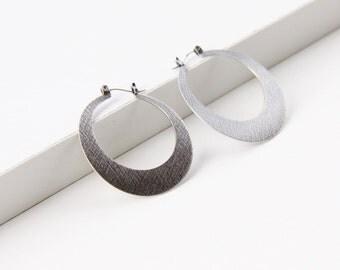 "Modern silver hoop earrings, sleek design in crescent moon shape sturdy and lightweight design for everyday wear - ""Silver Lunar Hoops"""