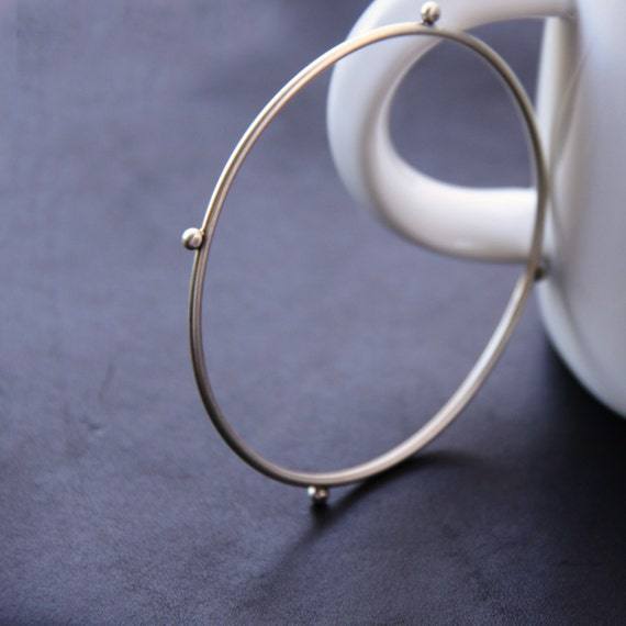 """Modern silver bangle bracelet formed and forged of thick silver wire and accented with argentium balls - """"Compass Bangle"""""""