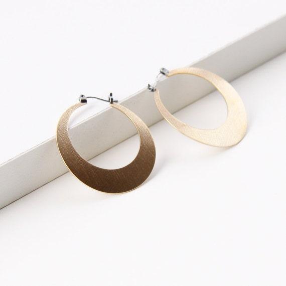 "Sleek hoop earrings handmade with embossed brass and flip flop type silver earwires, comfortable and lightweight - ""Lunar Hoops in Brass"""