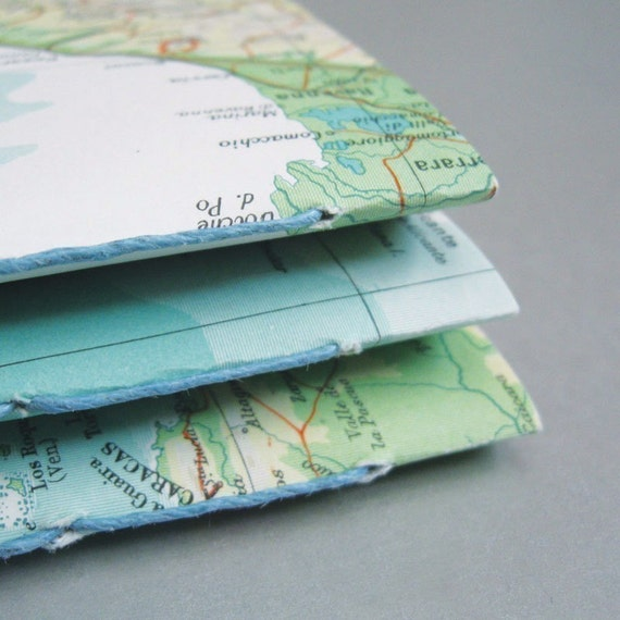 1 map notebook made with recycled paper that is post-consumer, reused, rescued, and found