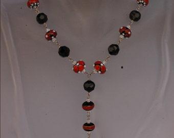 Kimadirose Handmade Lampwork and Swarovski Crystal Necklace  Earrings. Sterling