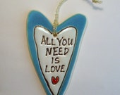 4.25 x 2.5x 3/8  All you need is Love Decoration