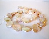 Freshwater coin pearls size large pale pink, peach, metallic in color 14-16mm 23 pieces