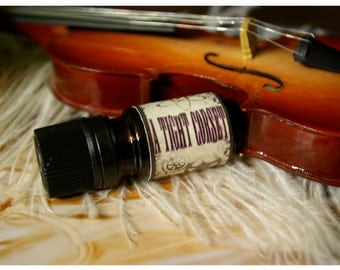 a tight corset - all natural perfume oil - 1/6 oz - primary notes: moroccan amber & cardamom - unisex