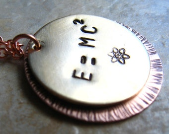 E equals MC squared - Einsteins Famous Physics Equation in a Copper Necklace