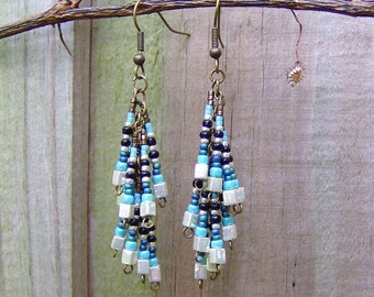 Old world glass seed beads drape beautifully from a hand fabricated design generating a look of pure Bohemian chic with a Tribal twist.