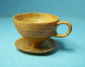 Carved Tea Cup and Saucer - One Piece