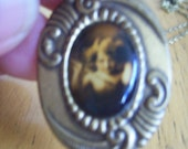 Vintage Antique pendant necklace With image of a girl in cabochon. Cameo,