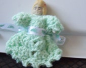 Frozen charlotte moving arms Japan  probably but no mark wire attached 3inch green dress.