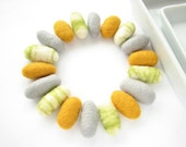 18 felted wool pebbles / beads (light gray, golden yellow, green/white marble)