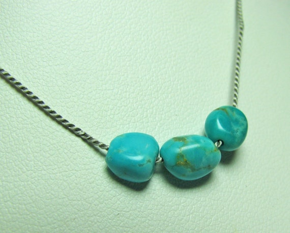 Turquoise bead necklace on silk cord