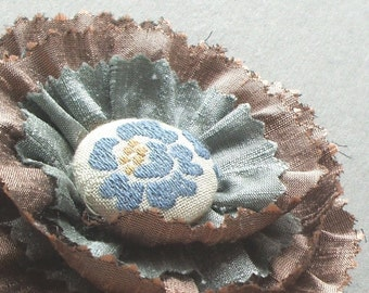 Caramel silk flower corsage brooch with vintage cover button by Clare Webster Designs
