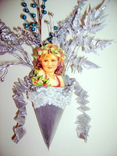Vintage girl with holly wreath and silver background