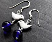 silver bird, cobalt blue