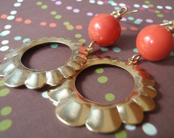Vintage gold-plated hoop earrings with vintage orange lucite rounds