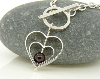 Sterling Silver Love Spinning Charm Bracelet with Garnet