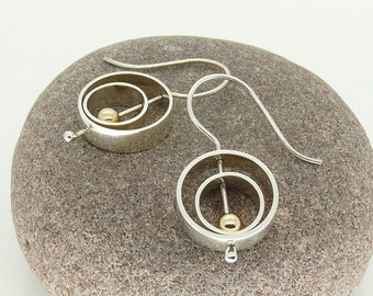 "Sterling Silver ""Serenity"" Kinetic Spinning Earrings with 9ct Gold detail"
