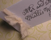 off white muslin calligraphy place cards