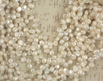"""Iridescent White Keishi Pearls Plump Top Drilled 15"""" strand (4130)"""