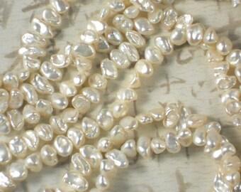 Keishi Pearls Bridal Creamy White Oval Side Drilled Hong Kong - Full Strand  (4135)