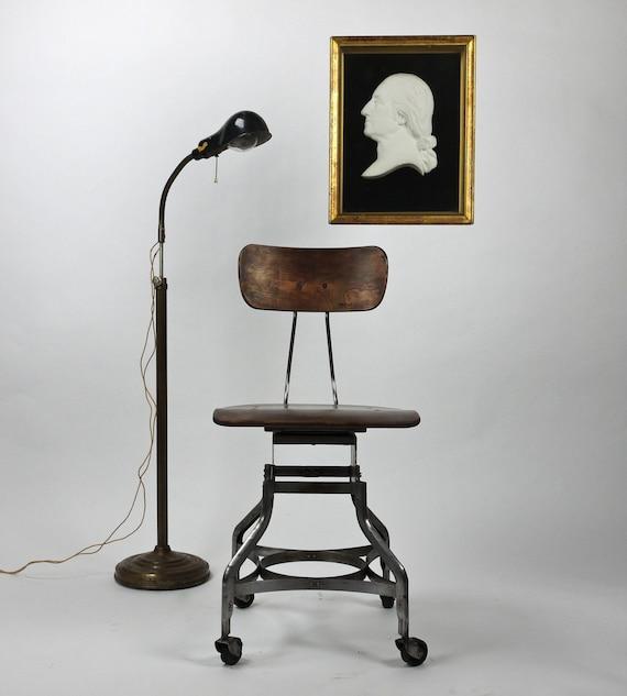 Antique industrial toledo drafting stool by dailymemorandum