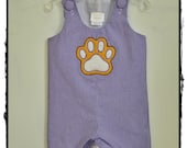 Purple Gingham Shortall with an appliqued pawprint
