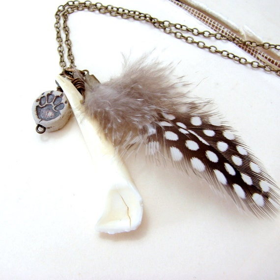 Talisman necklace w feather tooth and paw print