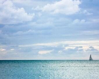 Photograph of Aruba Serene Silver Blue Caribbean Sea Ocean Water Sailboat on Horizon Minimal Nautical Coastal Home Decor Wall Art Print