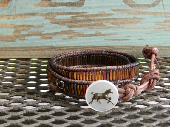 Bugle bead and leather wrap bracelet with horse button closure.Button is a special mother of pearl button from the mid century.