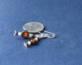 Earrings with orange dyed quartz, mother of pearl and hematite