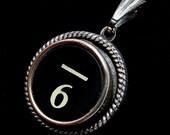 6 is for  Six Millimeters Under (Score) -  Vintage typewriter key pendant