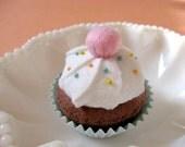 Old-fashioned vanilla and chocolate felt cupcake