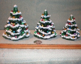 Three Pretty Little Ceramic Christmas Trees With Snow All Different Sizes