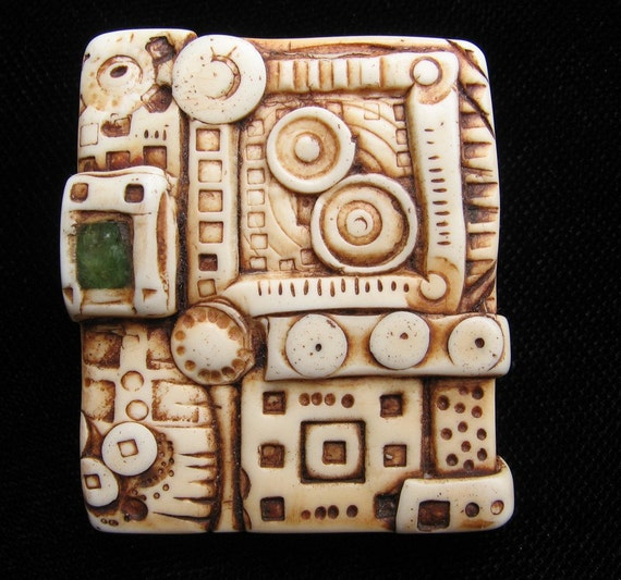 handmade faux carved ivory pendant-- City Square