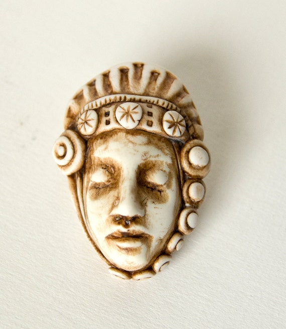 handmade faux ivory dreaming face pendant with scalloped crown