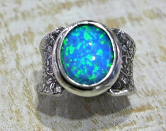 Sterling silver Opal Ring, sized to fit at no extra charge.